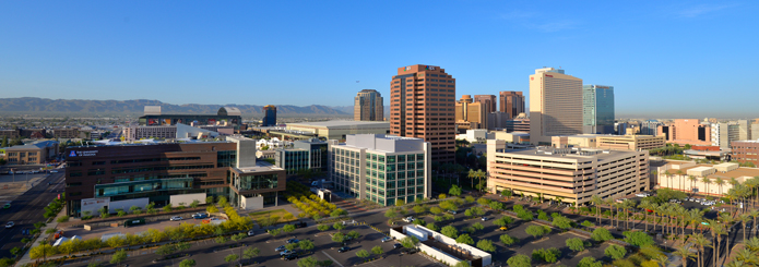 Wide-angle shot of buildings of downtown Phoenix and bright blue sky